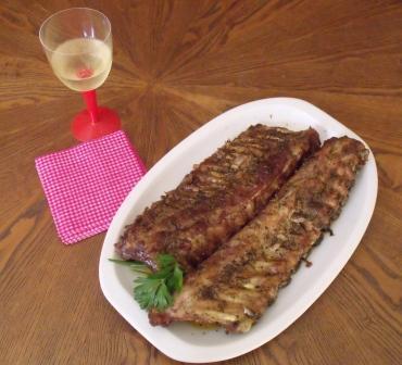 Presentación de costillas de cerdo asadas - DeFiestaEnCasa
